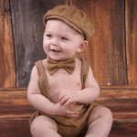 Cute infant with a bowtie on. From Enlightened Photography.